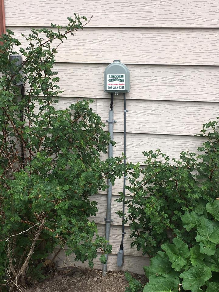 Image of Clearfield fiber product on side of residential house