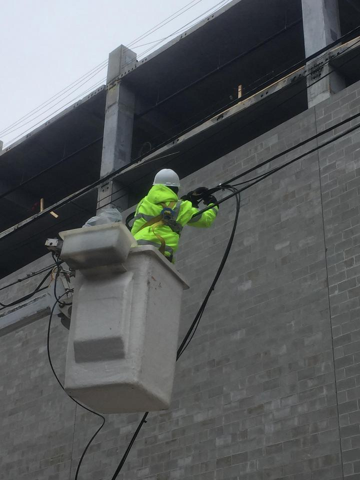 Image of a technician line worker fixing power lines
